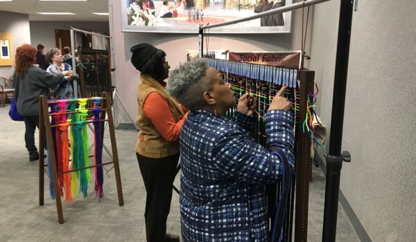 Community members weaving social fabric together